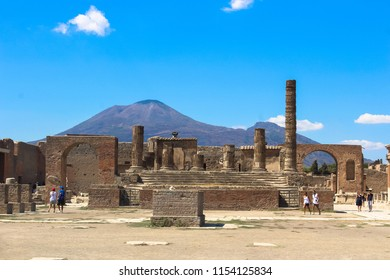 Pompei, Italy - August 14 2017: Ruins of Pompei, with Vesuvius in the background, the volcano that erupted in the summer of A.D. 79, burying the Roman town under several feet of ash and rock