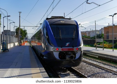 Pompei, Italy - February 09 2018: Trenitalia train stopped at station. An electric powered regional coach at Pompei station platform.