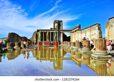 Pompei, Italy - September 19, 2016 : View of the roman ruins and Bronze statue at Pompeii Archaeological Park in Pompei on September 19, 2016.