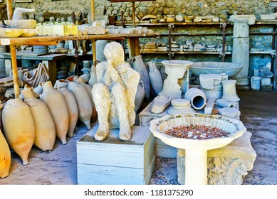 Pompei, Italy - September 19, 2016 : View of the roman ruins and Plaster casts of victims destroyed by the eruption of Mount Vesuvius centuries ago at Pompeii Archaeological Park in Pompei on Septembe