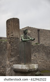 Pompeii, Italy - 3 JANUARY 2012: Bronze statue of Diana, goddess of the hunt and sister of god Apollo in the Apollo temple in Pompeii which was destroyed by eruption of the Vesuvius in 79 AD