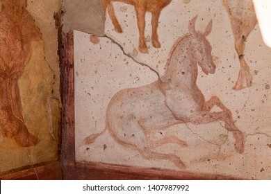 Pompeii, Italy. Ancient Frescoes In Wall Of Old House. UNESCO World Heritage Site