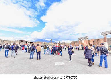 Pompeii, Italy - APRIL 14, 2019: Tourists Visiting the Ancient Ruins of Pompeii
