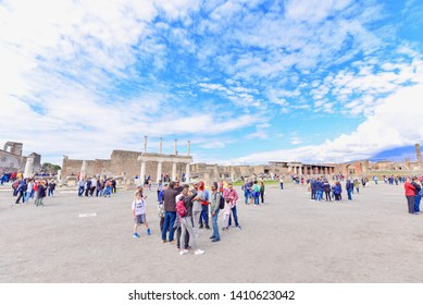 Pompeii, Italy - APRIL 14, 2019: Ancient Ruins of Pompeii City with Tourists