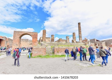 Pompeii, Italy - APRIL 14, 2019: Tourists Visiting Historical Ruins of Pompeii City, a UNESCO World Heritage Site