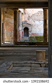 Pompeii, Italy - April 25, 2019: the lararium, a small aedicula dedicated to the worship of the Lares, in the peristylium of the house of the Tragic Poet.