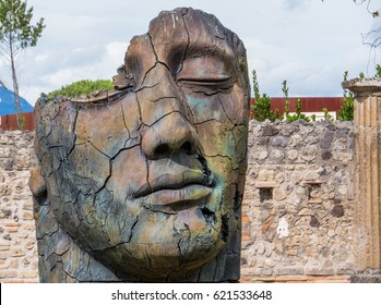 POMPEII, ITALY - JULY 16, 2016 - Sculptures of the Polish sculptor Igor Mitoraj on display at Pompeii archaeological site, the ancient Roman city, destroyed in 79 BC by the eruption of Mount Vesuvius.