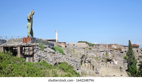 Pompeii / Italy - July 6, 2019:  Ruins of Pompeii city destroyed in 79 B.C. by the eruption of Vesuvius Volcano , Italy.  Blue sky