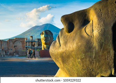 Pompeii, Italy - October, 12, 2016 - People enjoy a beautiful autumn day to visit the archaeological site of Pompeii with the Mount Vesuvius in the background