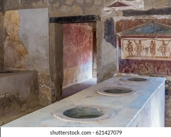 Pompeii, Italy - Traditional house kitchen in Pompeii, the ancient Roman city, destroyed in 79 BC by the eruption of Mount Vesuvius. UNESCO World Heritage Site.