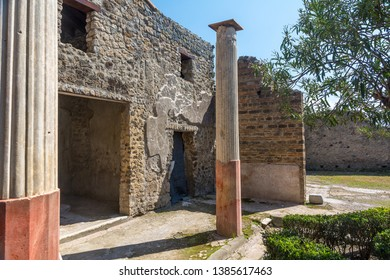 Pompeii,Italy-March 27, 2016: Columns and ruins inside the Pompeii archeological site near Naples during a summer day.