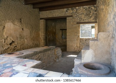 Pompeii,Italy-March 27, 2016:inside of the house in Pompeii archeological site near Naples during a summer day.