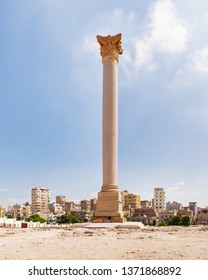 Pompey's Pillar, Roman triumphal column, with two Sphinx statues located at the Serapeum of Alexandria. Ancient architectural landmark in Egypt.