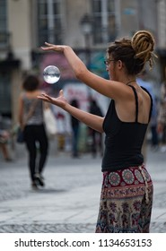 "Pompidou Centre, Paris, France June 2018: Street performer  ""levitates"" crystal ball at the Pompidou Centre, Paris France"