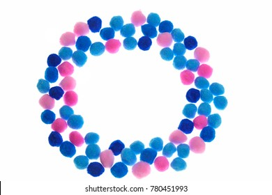 Pompon background. round frame of pink, light blue and blue small pompons isolated on white background. Needlework, hobby, creativity with children concept