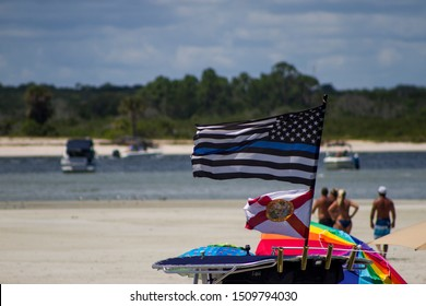 PONCE INLET - FLORIDA - USA 08-25-19  BLUE LIVES MATTER AND FLORIDA STATE FLAGS FLYING ON BOAT