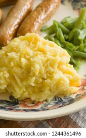 Ponchmipe a traditional dish of mashed potatoes and swede or turnip flavoured with butter and milk originally from North Wales in the UK