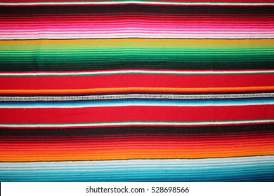 poncho background Cinco de mayo Mexican serape fiesta pattern traditional culture blanket with stripes pattern copy space fabric textile material Mexican backdrop - stock photo stock photograph image