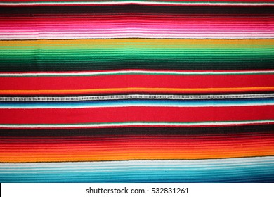 poncho Mexican cinco de mayo rug blanket serape fiesta traditional Mexico poncho background Mexican stripes copy space blanket minimal simple cinco de mayo serape pattern background  -  stock photo