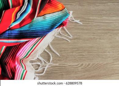 poncho serape background Mexican cinco de mayo fiesta wooden copy space stripe pattern  minimal simple minimalist flat lay