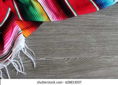poncho serape background Mexican cinco de mayo fiesta wooden copy space stripe pattern minimalist simple - stock photo, stock photograph, stock image, picture