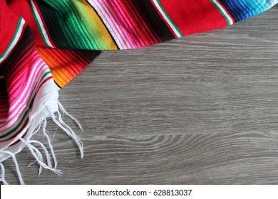 poncho serape background Mexican cinco de mayo fiesta wooden copy space stripe pattern minimalist simple