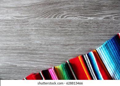 poncho serape background Mexican cinco de mayo fiesta wooden copy space stripe pattern