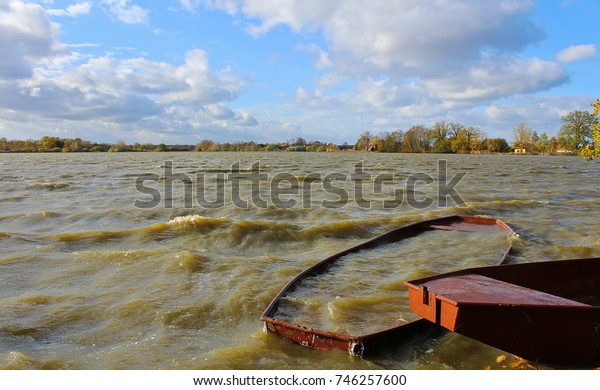 Pond with big wave in strong wind with two boats. Czech landscape