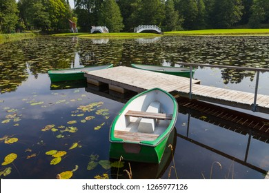 Pond and boat, summer warm moment
