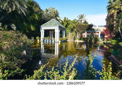 Pond and colorful structures of the Majorelle Garden / Jardin Majorelle, Marrakech, Morocco