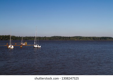 Velké Dářko pond in Czech republic with some yachts in a recreational harbor. Popular regional outdoor destination. Summer, blue cloudless sky.