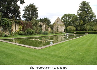 pond in front of ruined barn