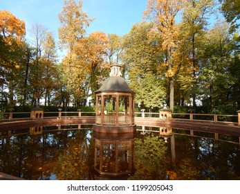A pond and a gazebo in the fall of the Summer Garden in St. Petersburg