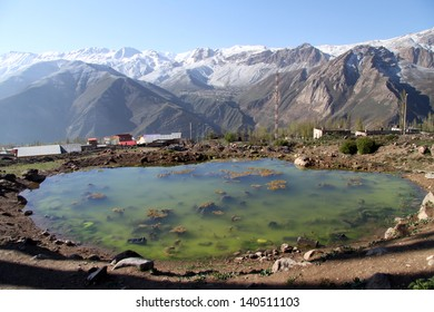 Pond with green grass in water in mountain area near Damavand volcano in Iran