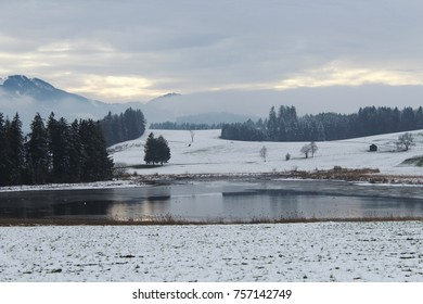 Pond in an idyllic misty winter landscape, Alpine Upland, Allgau, Bavaria