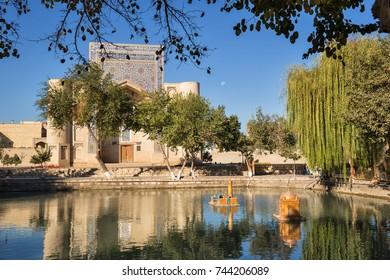 Pond Lyabi Khauz with miniature sights of Bukhara and Nadir Divan-Beghi Khanaka in the background, Uzbekistan
