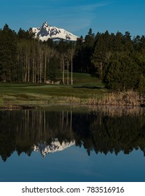 A pond on Black Butte Ranch Golf Course reflects Broken Top Mountain