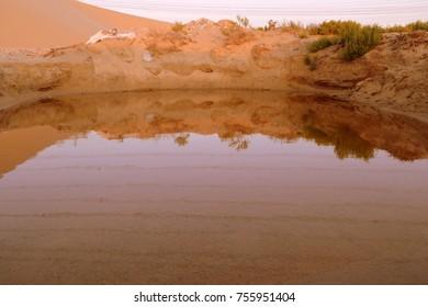 A Pond Reflecting upon Itself in the Dunes of the Arabian Desert, Dammam. Eastern Province, Kingdom pf Saudi Arabia