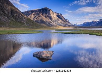 Pond reflections in Akshayuk Pass, Baffin Island, Nunavut