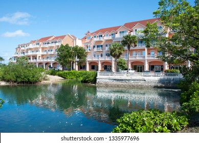 The pond with reflections in Sandyport village, the resort district in Nassau city (Bahamas).