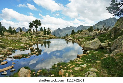 Pond with reflections in the shelter of Amitges, Aiguestortes, Pyrenees, Lleida, Catalonia