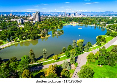 Pond reflections surrounded by Green landscape nature meets city in Denver , Colorado , USA Aerial drone view above City Park green space with pond and large trees Rocky Mountain background