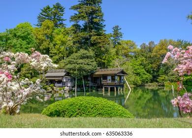 Pond and tea house in Kenrokuen, a japanese garden in Kanazawa, Ishikawa prefecture, Japan