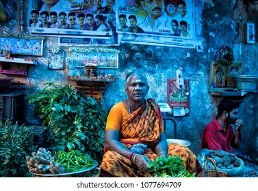 Pondicherry, India - August 2017: Woman selling vegetables at Goubert Market