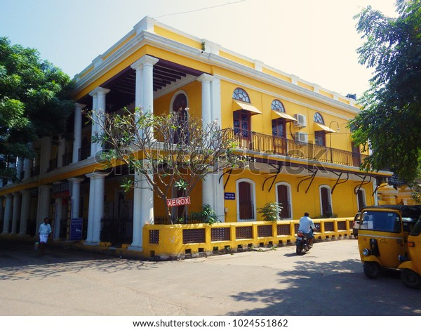 PONDICHERRY, INDIA - March 2016: Yellow house at Pondicherry street, colonial French architecture on Pondicherry city in Tamil Nadu, India