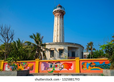 Pondicherry, Puducherry, February, 19,2019:   Exterior view of old  Light House with colorful wall graffiti against blue sky ,near Promenade Beach  front,  Puducherry, India, Asia
