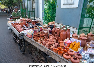 Pondicherry, Puducherry, February, 19,2019:Woman street vendor  selling  gift items, handicrafts, and art articles of terracotta and ceramics as souvenirs  on street of Puducherry, India,Asia,