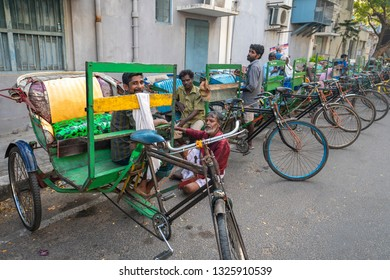 Pondicherry, Puducherry,  February,19,2019:  wide angle  view of multiple Bicycle Rikshaws  parked in a row on the street of Puducherry, India ,Asia