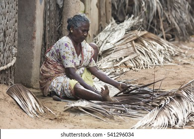 Pondicherry, Tamil Nadu, India - July 03, 2014. Poor woman worker in small village, very hard work for little money roupies