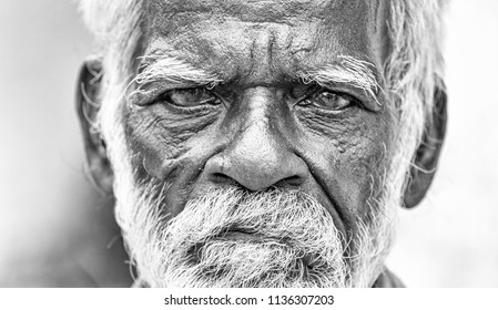 PONDICHERY, PUDUCHERRY, TAMIL NADU, INDIA - SEPTEMBER CIRCA, 2017. An unidentifed old senior indian poor man portrait with a dark brown wrinkled face and white hair and a white beard, looks serious